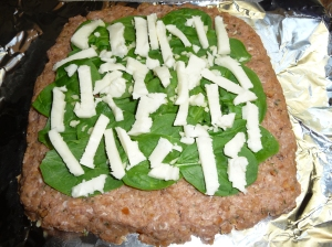Meatloaf stuffed with spinach, mozzarella cheese, and fresh garlic